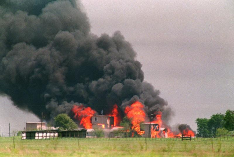 FILE - In an April 20, 1993 file photo, flames engulf the Branch Davidian compound in Waco, Texas. The 20th anniversary of the botched raid on the Branch Davidians compound passed passed quietly Thursday, Feb. 28, 2013, as colleagues of the four agents who died gathered in private and local officials made no plans to note the day. The Bureau of Alcohol, Tobacco, Firearms and Explosives held a ceremony in Waco to honor agents Conway LeBleu, Todd McKeehan, Robert John Williams and Steven Willis, the four agents who died in the Feb. 28, 1993 raid. Six Davidian members also died in that raid, which began a 51-day standoff that ended in a fire and the deaths of about 80 more sect members, including two dozen children.  (AP Photo/Susan Weems, File)