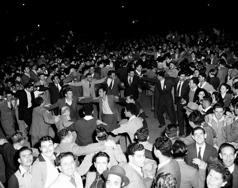 FILE - In this Nov. 30, 1947 file photo, Jewish people gather in the streets of Tel Aviv, many dancing after the United Nations announcement for a plan of the partition of Palestine and the new Jewish state.(AP Photo/Jim Pringle, File)