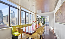 <p>The modern dining room also has plenty of natural light and is centred around a French-deco mahogany table. (Douglas Elliman) </p>