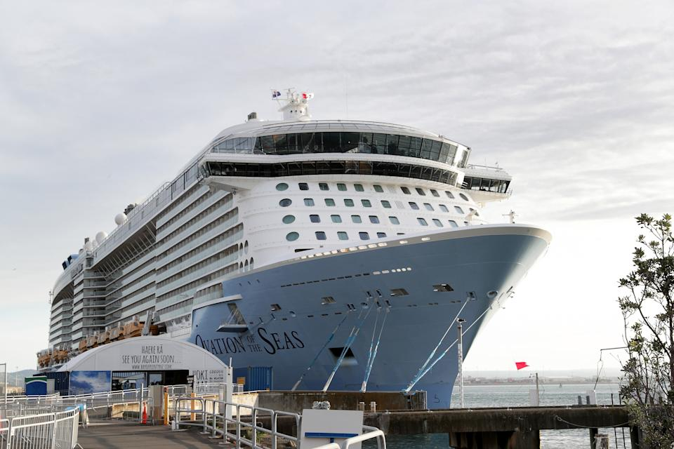 Ovation of the Seas cruise berthed after passengers touring White Island caught in volcano that killed six.