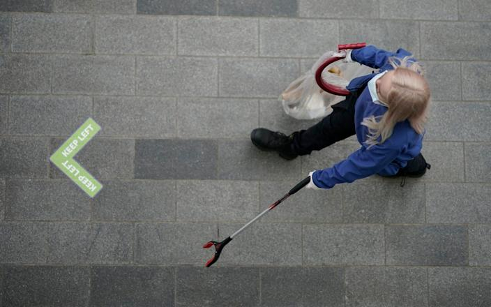 Cleaning personnel wears a face mask on July 14, 2020 in Liverpool, United Kingdom. The UK government has announced that people entering shops will be required to wear a face mask by law from July 24. Scientists have also predicted a 'worse case scenario' of a second wave of Covid-19 related deaths between 24,500 and 251,000 in hospitals alone in a report requested by the UK's chief scientific adviser, Sir Patrick Vallance - Christopher Furlong/Getty