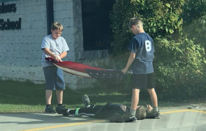 Three fifth-grade boys go viral for properly folding the American flag after school. (Photo: Facebook)