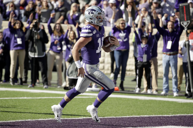Kansas State quarterback Skylar Thompson rushed for four touchdowns in the win over Oklahoma. (AP Photo/Charlie Riedel)