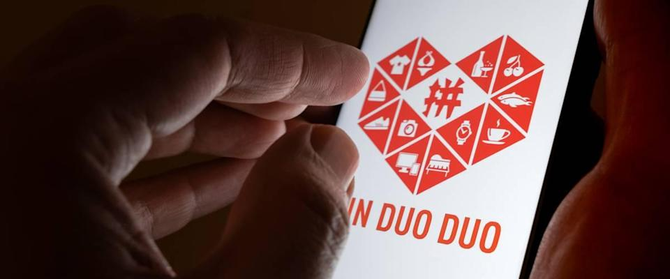 PinDuoDuo company logo on the smartphone hold in hands