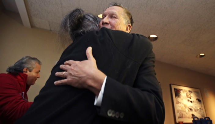 Ohio Gov. John Kasich, a potential 2020 Presidential candidate, is embraced by a supporter in Concord, N.H., Thursday, Nov. 15, 2018. The visit marked Gov. Kasich's second trip to the state this year. (AP Photo/Charles Krupa)