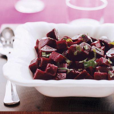 """<p>Fresh chopped basil is a cool counterpart to sweet, roasted beets in this easy-to-prepare side dish. Serve with roasted chicken for a delicious dinner.</p><p><strong><a href=""""https://www.countryliving.com/food-drinks/recipes/a6970/basil-balsamic-beets/"""" rel=""""nofollow noopener"""" target=""""_blank"""" data-ylk=""""slk:Get the recipe"""" class=""""link rapid-noclick-resp"""">Get the recipe</a>.</strong></p><p><strong><a class=""""link rapid-noclick-resp"""" href=""""https://www.amazon.com/Chicago-Metallic-Professional-Non-Stick-13-Inch/dp/B003YKGRG4/?tag=syn-yahoo-20&ascsubtag=%5Bartid%7C10050.g.34063059%5Bsrc%7Cyahoo-us"""" rel=""""nofollow noopener"""" target=""""_blank"""" data-ylk=""""slk:SHOP ROASTING PANS"""">SHOP ROASTING PANS</a><br></strong></p>"""