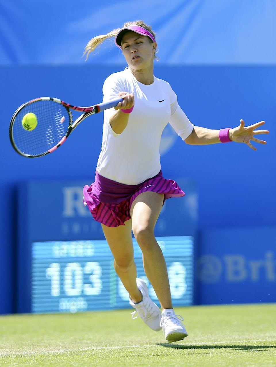 Canada's Eugenie Bouchard returns the ball to Switzerland's Belinda Bencic during day five of the women's international tennis tournament at Devonshire Park, Eastbourne, England, Wednesday June 24, 2015. (Gareth Fuller/PA via AP) UNITED KINGDOM OUT NO SALES NO ARCHIVE