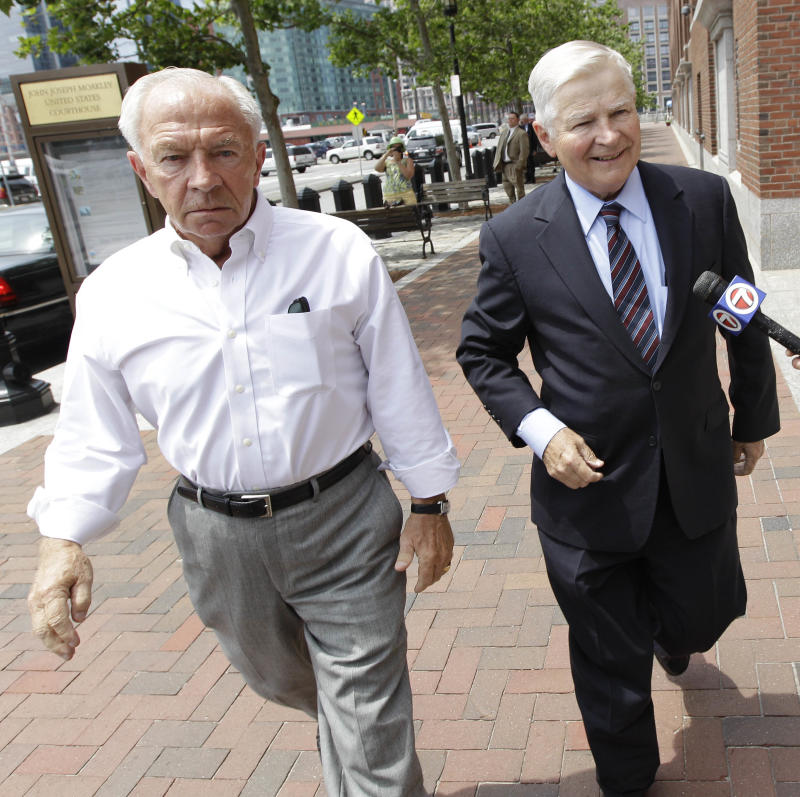"John, left, and William Bulger arrive at federal court in Boston for the arraignment of their brother James ""Whitey"" Bulger on 19 murder counts Wednesday, July 6, 2011.  (AP Photo/Stephan Savoia)"