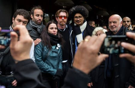 Eagles of Death Metal singer Jesse Hughes (C) poses with people in front of the Bataclan concert hall in Paris, France, November 13, 2016, during a ceremony held for the victims of last year's Paris attacks which targeted the Bataclan concert hall as well as a series of bars and killed 130 people.    REUTERS/Christophe Petit Tesson/Pool