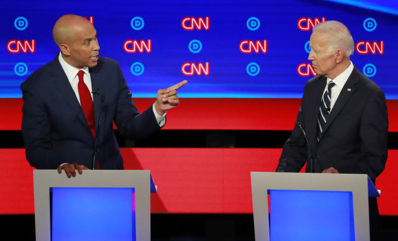 U.S. Senator Cory Booker points to former Vice President Joe Biden on the second night of the second 2020 Democratic U.S. presidential debate in Detroit, Michigan, July 31, 2019. REUTERS/Lucas Jackson