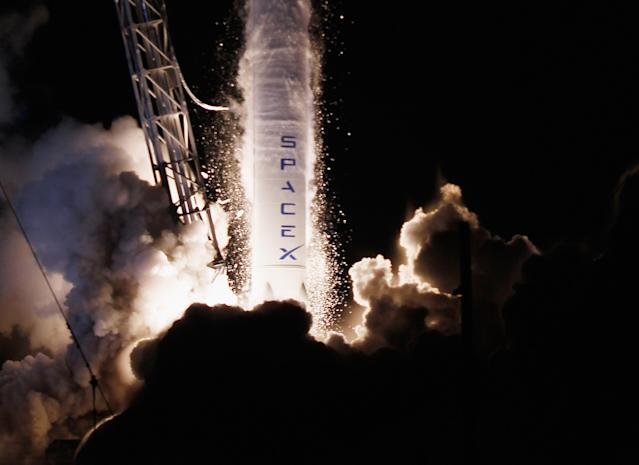 A SpaceX Falcon 9 rocket attached to the cargo-only capsule called Dragon lifts off from the launch pad on October 7, 2012 in Cape Canaveral, Florida. The rocket is bringing cargo to the International Space Station that consists of clothing, equipment and science experiments. (Photo by Joe Raedle/Getty Images)