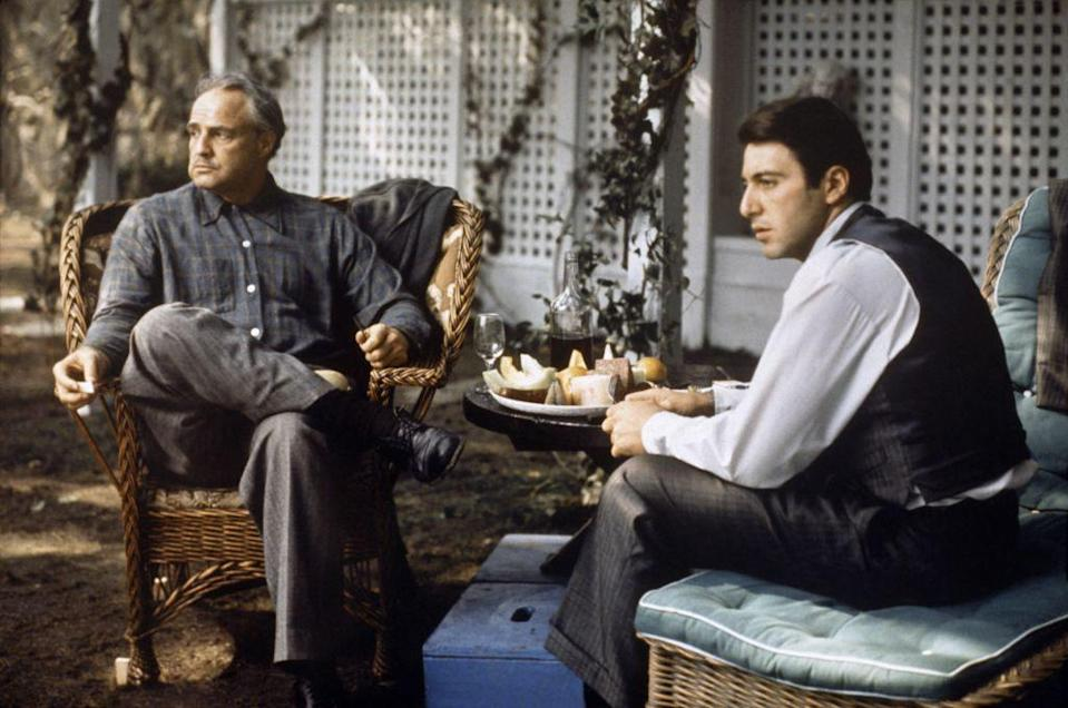 <p>Brando and Pacino, both strict method actors, take direction while on set. </p>