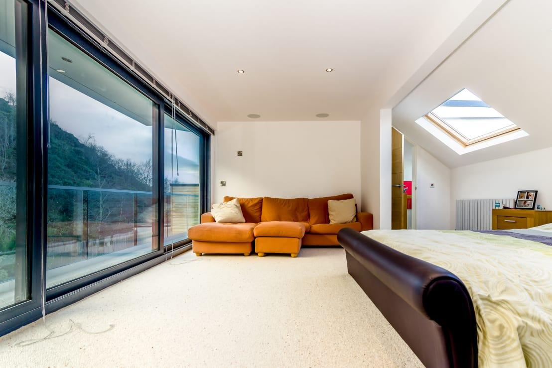 """<p>The master suite is now in what was previously the old attic, complete with a new balcony providing picture-perfect views of the rear garden and beyond.</p><p>Carpenters, contractors, and many more – we have them all here on homify. See our<a rel=""""nofollow"""" href=""""https://www.homify.co.uk/professionals"""">professionals</a> page for more info.</p>  Credits: homify / Capital A Architecture"""