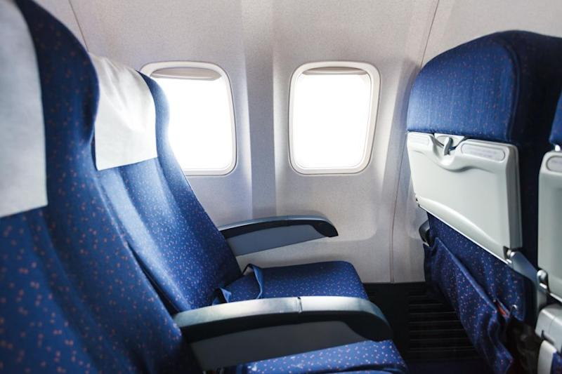Experts suggest to only recline your seat halfway. Photo: Getty