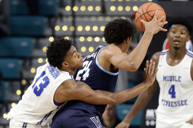 Middle Tennessee State guard Jayce Johnson (13) reaches around Villanova forward Jeremiah Robinson-Earl (24) during the first half of an NCAA college basketball game at the Myrtle Beach Invitational in Conway, S.C., Thursday, Nov. 21, 2019. (AP Photo/Gerry Broome)