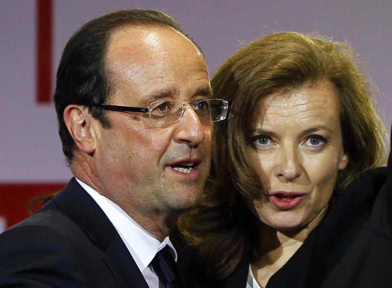 "FILE This Sunday, May 6, 2012 file photo shows French president-elect Francois Hollande reacting to supporters with his companion Valerie Trierweiler while celebrating his election victory in Bastille Square in Paris, France. More than three weeks after her partner Francois Hollande took office as France's president, Valerie Trierweiler still doesn't know what she wants to be called.In an interview Thursday June 7, 2012 on France-Inter radio, Trierweiler said she feels the term ""first lady"" is a bit old-school, and she's been fielding ideas about the right way to refer to her. (AP Photo/Francois Mori)"