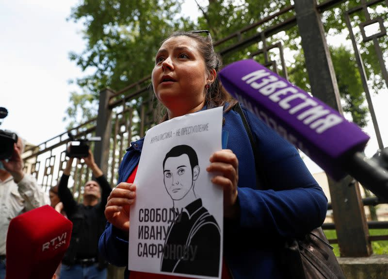 A participant stages a picket in support of former journalist Ivan Safronov in Moscow
