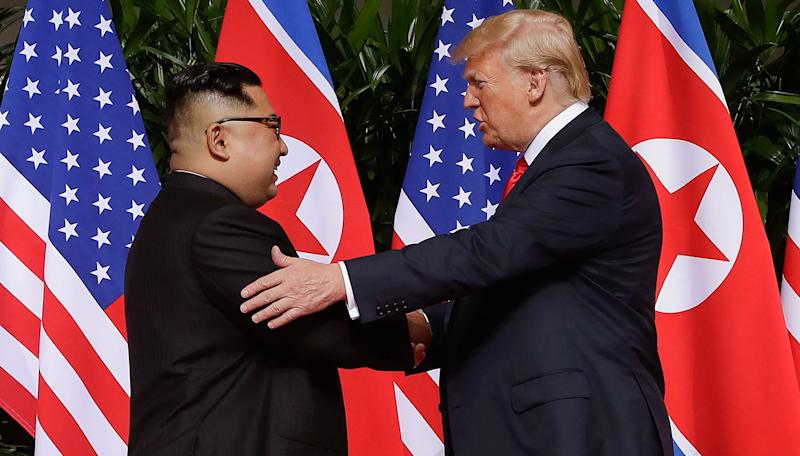 Trump, Kim shake hands to begin historic summit