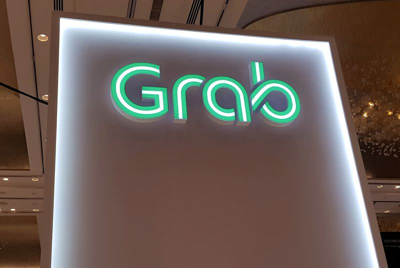 FILE PHOTO: A Grab logo is pictured at the Money 20/20 Asia Fintech Trade Show in Singapore