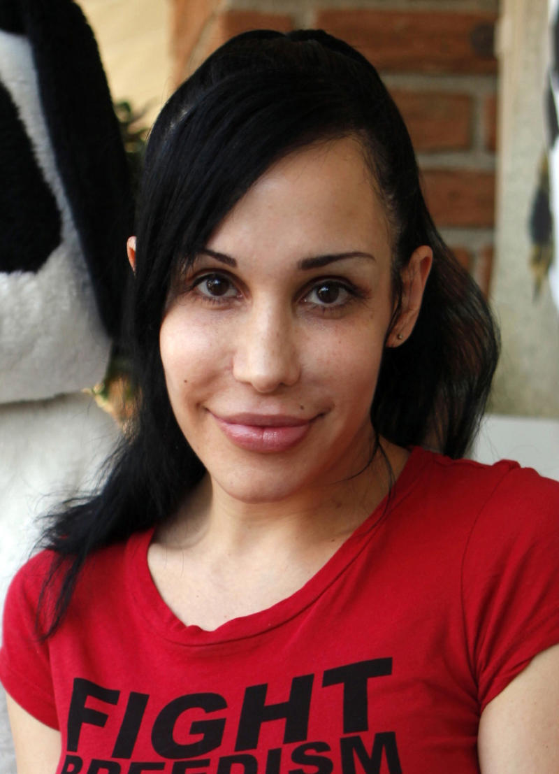 "FILE - In this May 19, 2010 file photo, ""Octomom"" Nadya Suleman poses for photos outside her La Habra, Calif., home. Suleman has filied for bankruptcy  and her home is scheduled to be auctioned on Monday,  May 7, 2012. (AP Photo/Damian Dovarganes, File)"