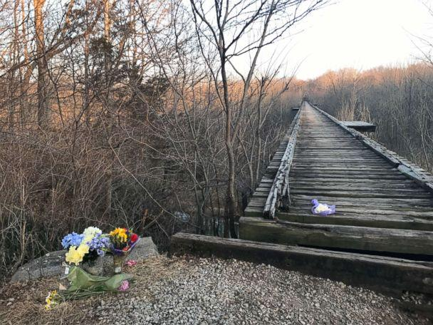 PHOTO: Flowers sit by a bridge near Delphi, Ind., where Liberty German and Abigail Williams were seen before they were reported missing by their families on Feb. 13, 2017. (Alex Perez/ABC News)