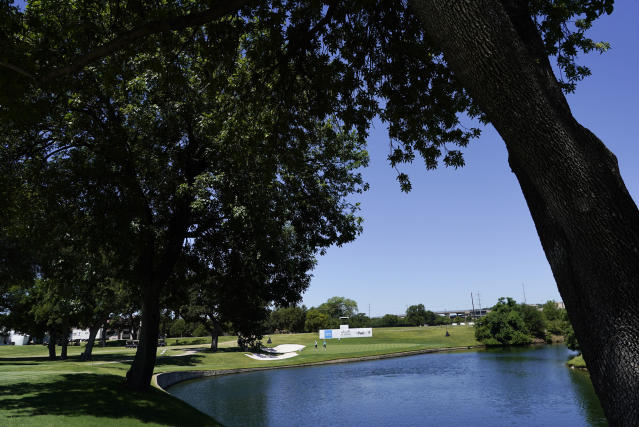 Dustin Johnson walks off the 13th green during practice for the Charles Schwab Challenge golf tournament at the Colonial Country Club in Fort Worth, Texas, Wednesday, June 10, 2020. (AP Photo/David J. Phillip)