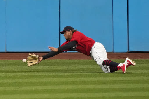 Cleveland Indians' Josh Naylor dives for a ball hit by Kansas City Royals' Maikel Franco during the ninth inning of a baseball game Thursday, Sept. 10, 2020, in Cleveland. Franco doubled. The Royals won 11-1. (AP Photo/Tony Dejak)