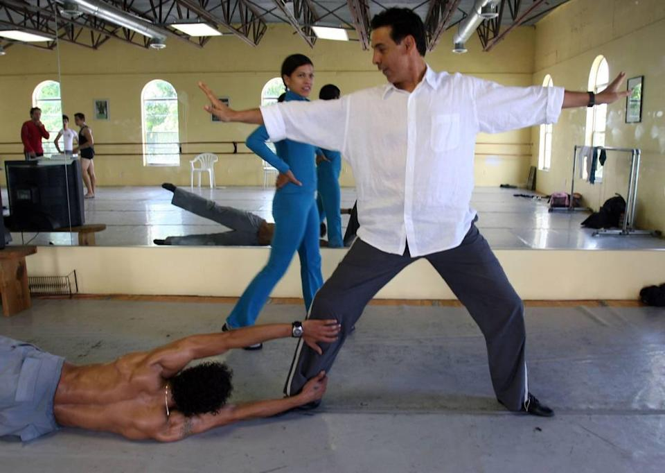 Artistic director Jimmy Gamonet de los Heros, center, worked with dancer, Isanusi Garcia Rodriguez, right, while dancer Iliana Lopez, back, observed during a rehearsal of Ballet Gamonet's first program in this 2005 file photo.