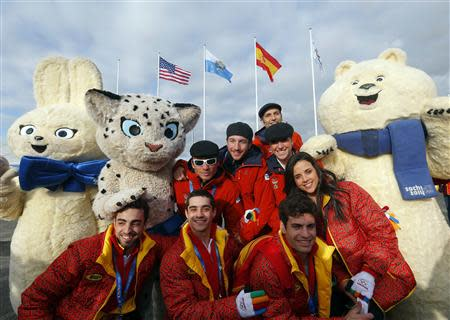 Members of the Spanish Olympic Team pose with an Olympic mascot during the welcoming ceremony for the team in the Athletes Village at the Olympic Park ahead of the 2014 Winter Olympic Games in Sochi February 6, 2014. REUTERS/Laszlo Balogh