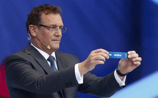 FIFA Secretary General Jerome Valcke holds the ticket of Australia during the draw ceremony for the 2014 soccer World Cup in Costa do Sauipe near Salvador, Brazil, Friday, Dec. 6, 2013. (AP Photo/Victor R. Caivano)