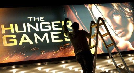 "Teen action film phenomenon ""The Hunger Games"" stayed on top of the North American box office for a second weekend"