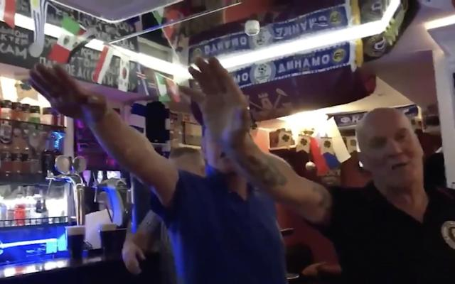 "England football fans have caused outrage by singing an anti-Semitic song and making Nazi salutes in a Russian pub before England's World Cup match in Volgograd, where more than a million Soviet soldiers died to stop the German blitzkrieg. In a video that was circulating on social media yesterday, supporters are singing a racially offensive song about Tottenham Hotspur in the Galereya Pub in Volgograd. An employee at the pub told The Daily Telegraph that the incident had occurred on Monday before England beat Tunisia 2-1. Three men are seen throwing Nazi salutes during the anti-Semitic song, which makes reference to Hitler and Auschwitz, and has been associated with some Chelsea supporters in the past. The incident threatens to cause tensions between countries during a World Cup that has otherwise been overwhelmingly friendly. Russia World Cup in pictures: Best photos of teams, games and players British police, who previously warned fans not to sing songs or wave flags at ""sensitive"" sites in Volgograd, said they were ""making swift inquiries to identify those involved and will seek to take all appropriate action against them"". An FA spokesman said: ""We strongly condemn the actions of the people in this video. We are working with the relevant authorities, including the UK Police investigations team, who are making inquiries to identify the individuals involved and take appropriate action. ""The disgraceful conduct of the individuals in this video does not represent the values of the majority of English football fans supporting the team in Russia."" Actions meant to incite hatred based on race or religion can be punished with up to five years in prison, according to the Russian criminal code. While the Russian authorities have installed stadium observers to catch discriminatory behaviour, African immigrants previously told The Telegraph that racism in the stands remains a problem. World Cup 2018 