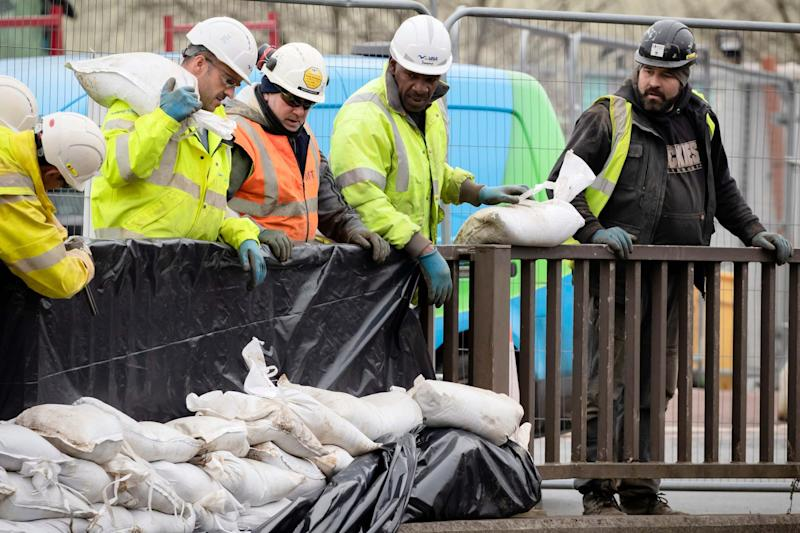 Workers construct flood defences in Mytholmroyd in the Upper Calder Valley in West Yorkshire, ahead of Storm Dennis: PA