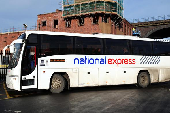 A National Express coach at a National Express bus Depot in Digbeth, Birmingham. The Train and bus operator said today that it planned to cut up to 750 jobs in a bid to save 15 million a year.