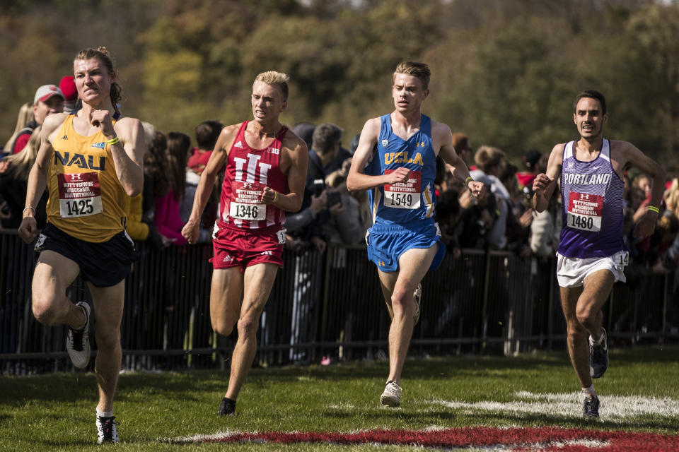 In this photo provided by Indiana Athletics, Indiana's Ben Veatch, second from left, competes in the Nuttycombe Invitational on Oct. 16, 2019, in Madison, Wisc. The impact of moving traditional fall sports to later in the calendar due to COVID-19 includes some consequences unrelated to the pandemic itself. That has been evident this week as Big Ten runners have prepared for Saturday's cross country championships at Shelbyville, Indiana. (Lauren Bacho/Indiana Athletics via AP)