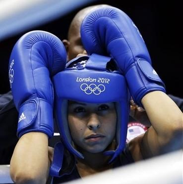 United States' Marlen Esparza prepares to fight Venezuela's Karlha Magliocco in a women's flyweight 51-kg quarterfinal boxing match at the 2012 Summer Olympics, Monday, Aug. 6, 2012, in London. (AP Photo/Patrick Semansky)
