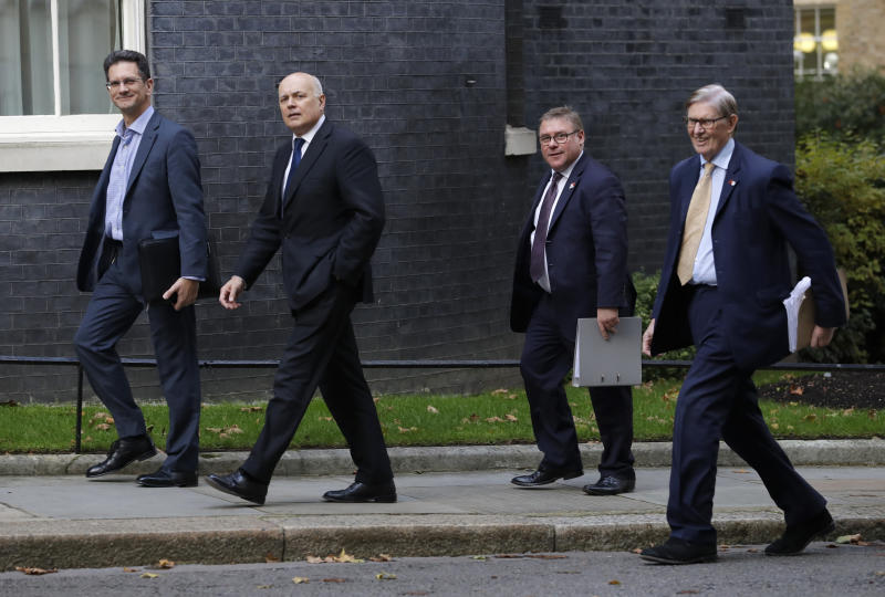 Britain's Conservative Party Politicians, from left, Steve Baker, Iain Duncan Smith, Mark Francois, and Bill Cash, walk up Downing Street for a meeting, in London, Wednesday, Oct. 16, 2019. Talks between the EU and Britain on the country's departure from the bloc are continuing after running through the night but that obstacles remain.(AP Photo/Kirsty Wigglesworth)