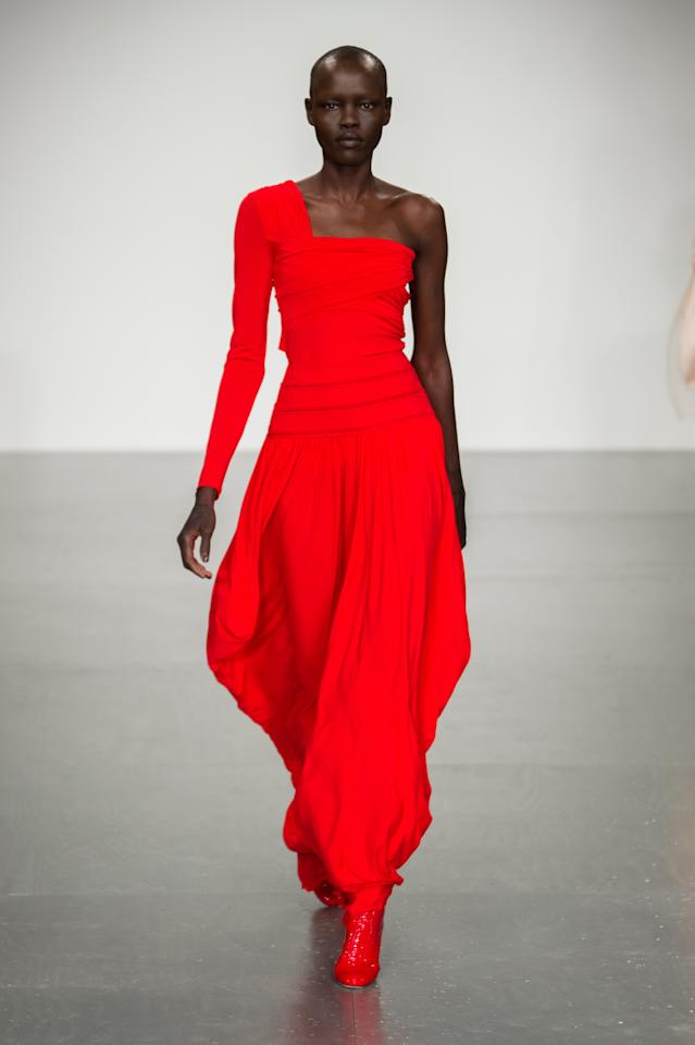 <p><i>A model wears a one-shoulder crimson-red gown. (Photo: ImaxTree) </i></p>
