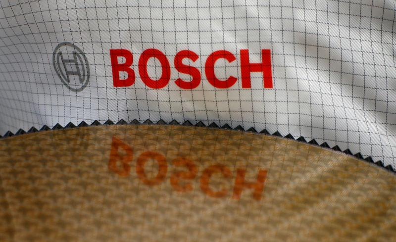 FILE PHOTO: The Bosch logo is reflected in a semiconductor wafer in Reutlingen