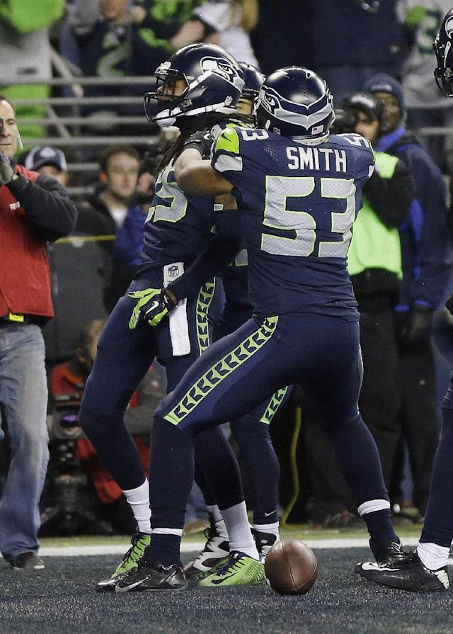 FILE - In this Sunday, Jan. 19, 2014 file photo, Seattle Seahawks' Richard Sherman reacts after tipping a pass intended for San Francisco 49ers' Michael Crabtree (15) in the final seconds of the second half of the NFL football NFC Championship game Sunday, Jan. 19, 2014, in Seattle. Seattle Seahawks cornerback Richard Sherman was fined $7,875 for unsportsmanlike conduct/taunting in the final minute of the NFC championship game against San Francisco, Friday, Jan. 24, 2014. (AP Photo/Marcio Jose Sanchez, File)