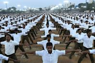 Members of the Rashtriya Swayamsevak Sangh participate in a rally in support of India's controversial citizenship law on the outskirts of Hyderabad on December 25, 2019 (AFP/STR)