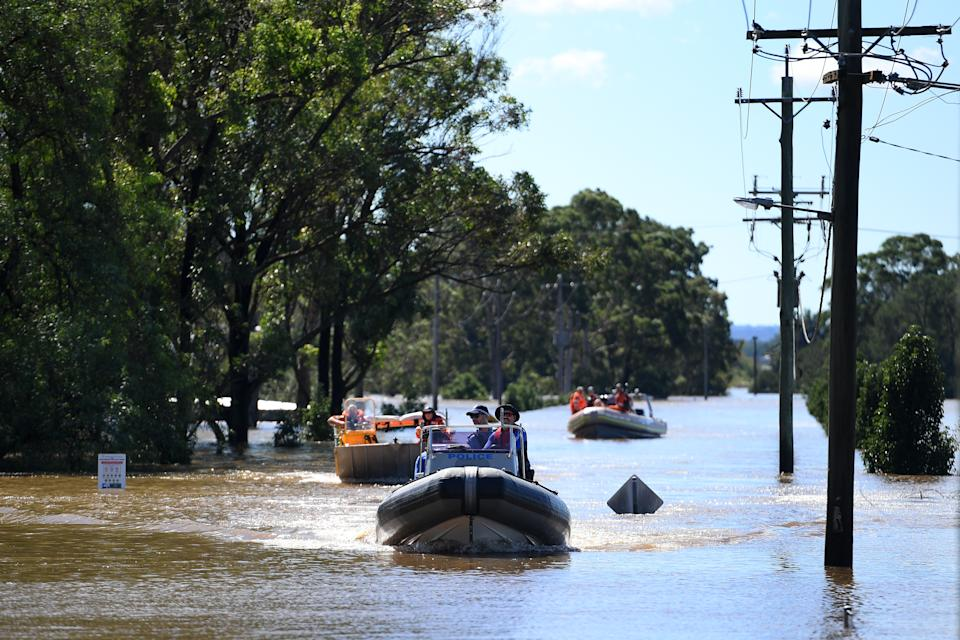 SES volunteers and NSW Police begin delivering food, medicine and essential items and inspecting properties inundated but floodwaters around Windsor in the north west of Sydney. Source: AAP