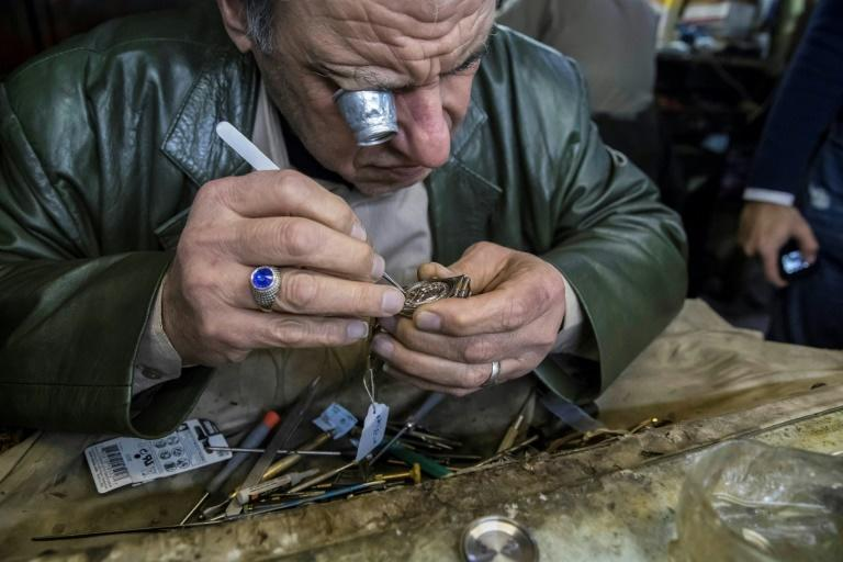 Samy Taha, a 63-year-old Egyptian watchmaker, repairs a watch at the Francis Papazian watchmaker's shop in the central Attaba district of Cairo