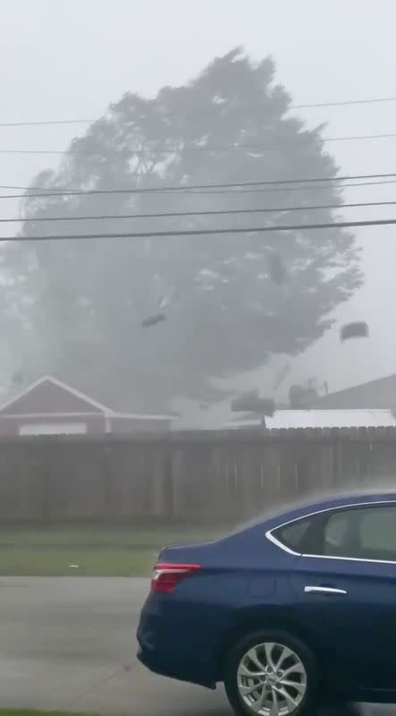 Parts of the roof of a building are blown off amidst strong wind and rain during Hurricane Zeta in Chalmette
