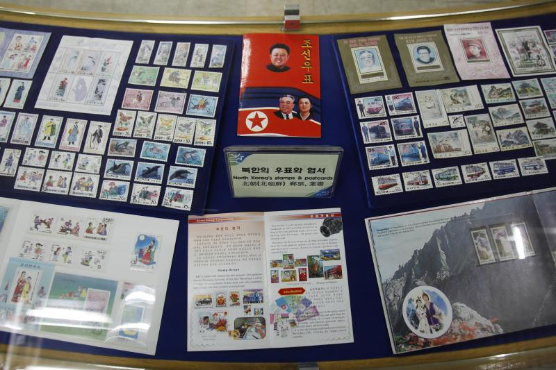 Stamps of North Korean national founder the late Kim Il Sung and late leader Kim Jong Il, center top, are displayed at the Unification Observation Post in Paju near the demilitarized zone between the two Koreas, South Korea,Thursday, March 14, 2013. Busloads of tourists still show up to gawk at the world's most heavily fortified border, even as governments on both sides threaten to reduce each other to rubble. (AP Photo/Ahn Young-joon)