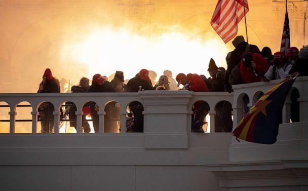 PHOTO: A flash bang is fired at supporters of President Trump who stormed the United States Capitol building in Washington, Jan. 6, 2021. (The Washington Post via Getty Images, FILE)