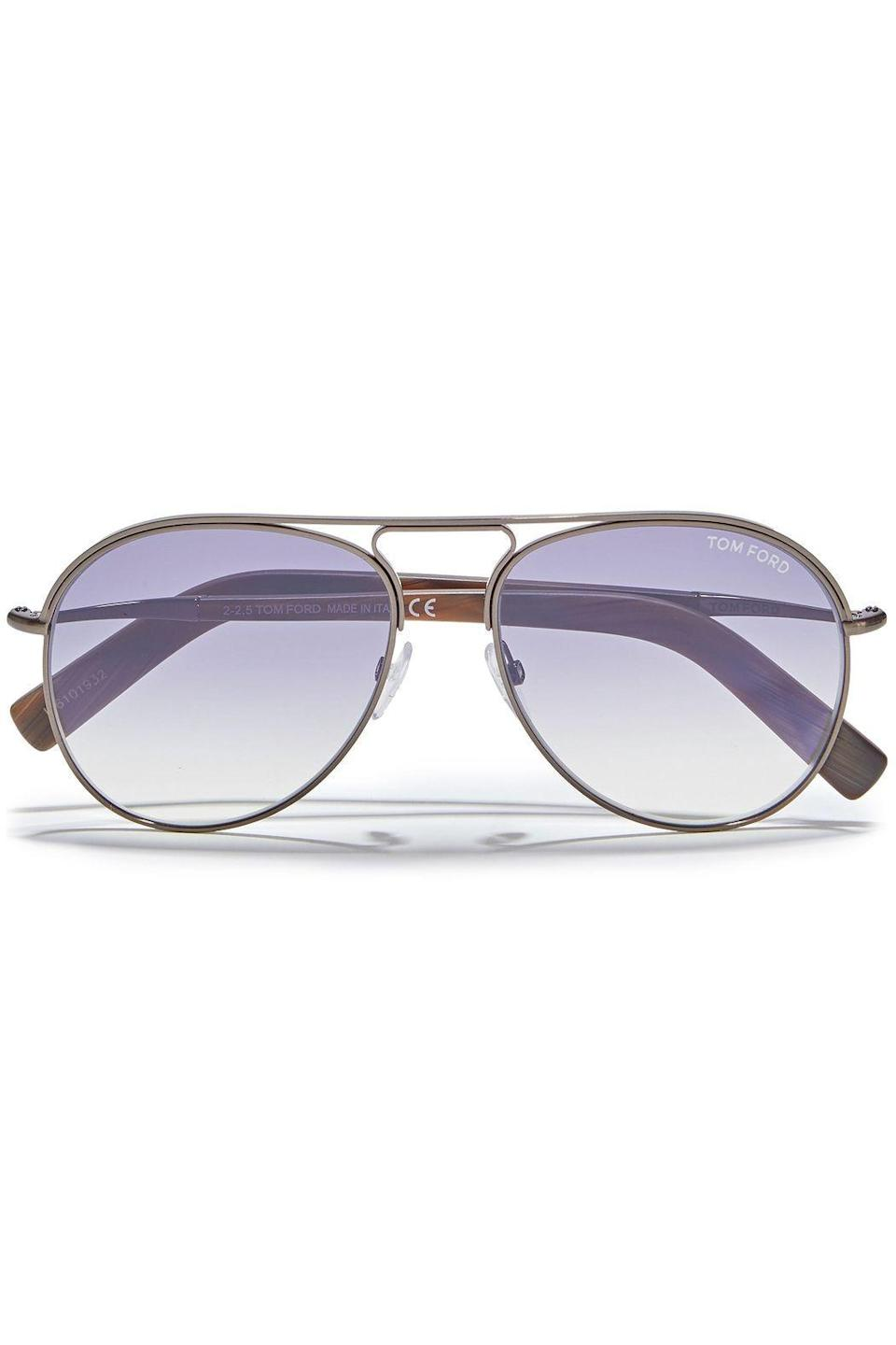 """<p><strong>TOM FORD</strong></p><p>theoutnet.com</p><p><strong>$148.00</strong></p><p><a href=""""https://go.redirectingat.com?id=74968X1596630&url=https%3A%2F%2Fwww.theoutnet.com%2Fen-us%2Fshop%2Fproduct%2Ftom-ford%2Fsunglasses%2Faviator%2Faviator-style-gunmetal-tone-sunglasses%2F17957409491053979&sref=https%3A%2F%2Fwww.elle.com%2Ffashion%2Fshopping%2Fg33595007%2Fthe-outnet-clearance-summer-2020-sale%2F"""" rel=""""nofollow noopener"""" target=""""_blank"""" data-ylk=""""slk:Shop Now"""" class=""""link rapid-noclick-resp"""">Shop Now</a></p>"""