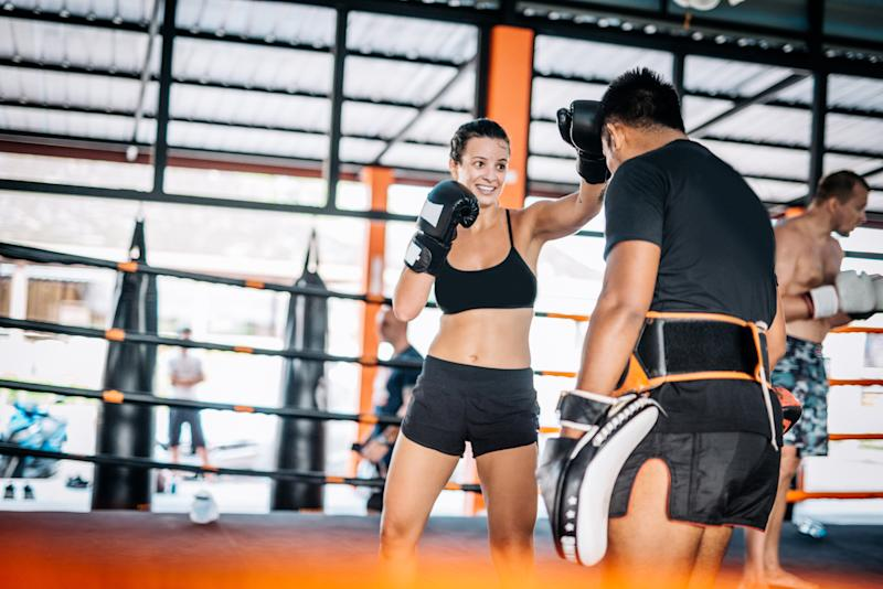 Martial arts are physical activities good for both men and women, recreational athletes or professional fighters. Many people coming to Thailand to practice and improve their technique with experienced local Muay Thai and MMA trainers. Woman using elbow technique to hit the focus mat