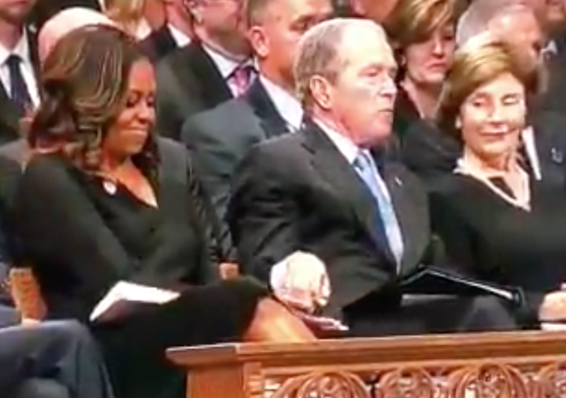 Did George W. Bush Just Sneak Michelle Obama A Piece Of Candy At McCain's Funeral?