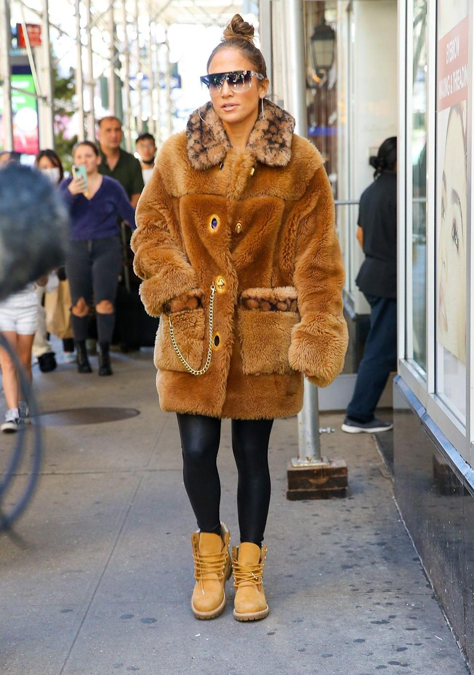 <p>Jennifer Lopez is ready for fall in a fur coat and black leggings in N.Y.C. on Sept. 24. </p>